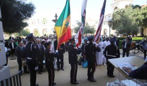 Guests stand for the U.S. Pledge of Allegiance and Senegal Pledge of Allegiance during the Welcome Reception for the Sister City of Dakar-Plateau in the Honor of his Excellency Alione Ndoye, Mayor of Daker-Plateau, Republic of Senegal and Esteemed Delegation at the Pasadena City Hall Courtyard, June 18, 2019.